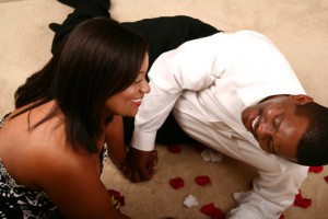 African American Couple Laughing On The Floor