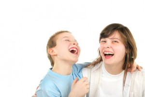 happy brother and sister laughing isolated on the white